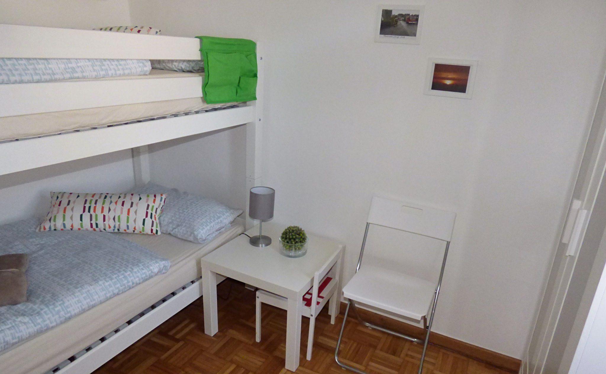 Ferienhaus Höhenflug - Schlafzimmer mit Etagenbett